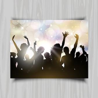 Bokeh 빛 배경에서 춤추는 사람들의 실루엣