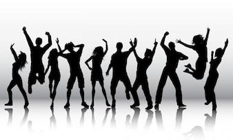 Силуэты людей танцуют