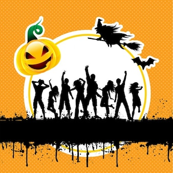 Silhouettes of people dancing on a grunge halloween background