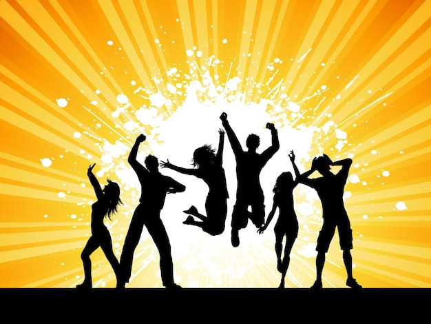Silhouettes of people dancing on a grunge starburst background