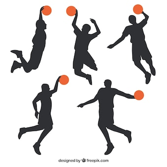 Silhouettes of several basketball players