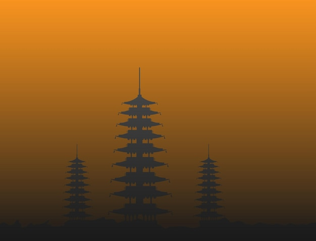 Silhouettes of the temples standing on the hill at dusk