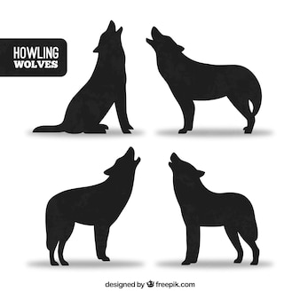 Silhouettes of wolves howling set