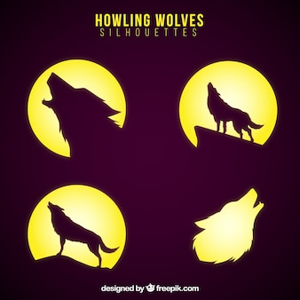 Silhouettes of wolves with moon