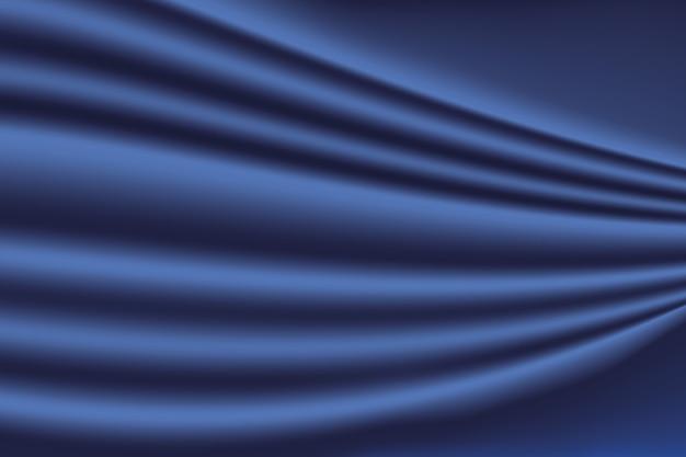 シルクまたはサテンのエレガントな抽象的な青い背景