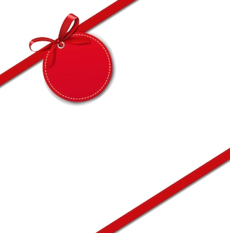 Silk red ribbon border with tag isolate on white