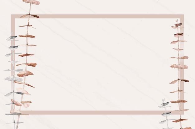 長方形のフレームテンプレートとシルバーとゴールドのユーカリの枝