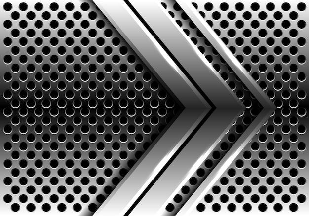 Серебряная стрелка на фоне круглой сетки.