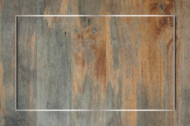 Silver frame on grunge wooden background