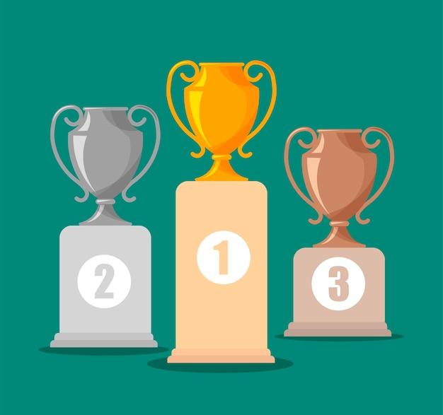 Серебряные, золотые и бронзовые кубки. награда или кубок победителя на пьедестале почета.