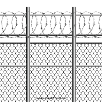 Silver metal fence with barbed wire
