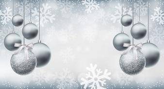 Серебряные блестящие безделушки на фоне снежинок