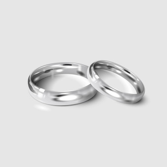 Silver wedding rings isolated on white. 3d realistic.