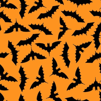 ハロウィーンのシンプルな背景。コウモリのシームレスなパターン。ベクトルイラスト