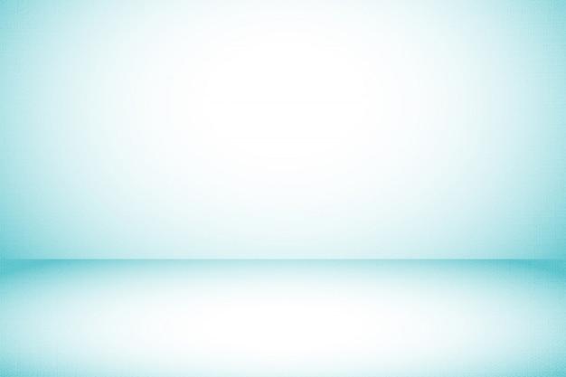 グラデーション表示として使用されるシンプルなブルーのスタジオ生地の背景
