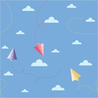 A simple childrens pattern of origami airplanes in the clouds