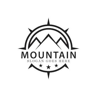 旅行や冒険のロゴデザインベクトルテンプレート用のシンプルなコンパスとライン山