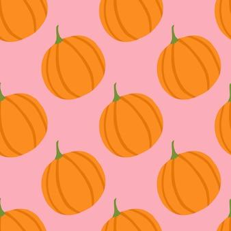 シンプルなミニマリズム食品カボチャのシームレスパターン。オレンジ色の野菜の要素を持つピンクの背景。
