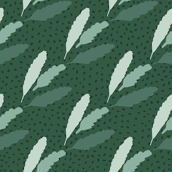 Simple seamless doodle pattern with floral leaves on green background with dots