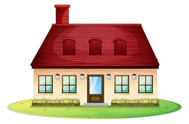 赤い屋根と煙突のある一戸建て