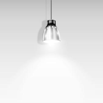 Single spotlight illuminating white wall