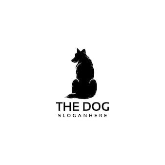 座っている犬のシルエットのロゴデザインベクトル