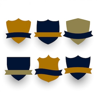 Six shield or badges symbols with ribbons set