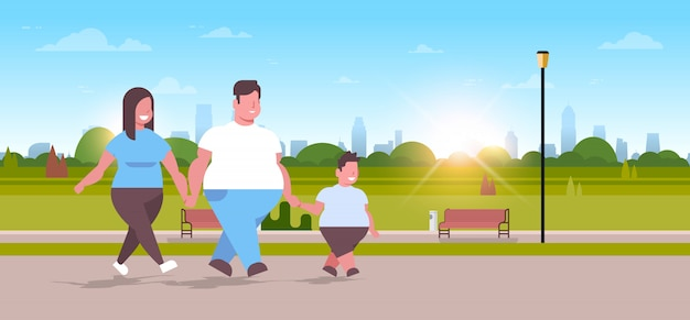 Over size family walking together urban park  her mother and son having fun unhealthy lifestyle obesity