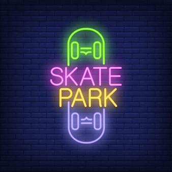 Skate park neon text on skateboard logo. neon sign, night bright advertisement