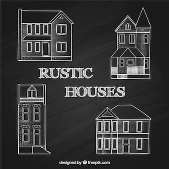 Skecthy rustic houses on blackboard Premium Vector