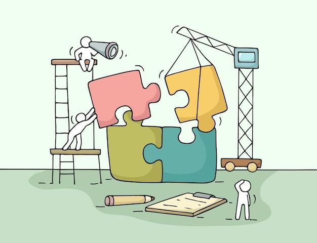 パズルのチームワークで働く小さな人々のスケッチ労働者がパズルのピースを集めるシーン