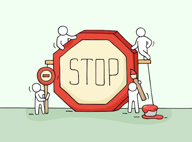 一時停止の標識で働く小さな人々のスケッチ。