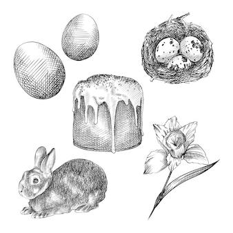 手描きのイースター属性のセットをスケッチします。セットは、染めた卵、イースターバニー、イースターケーキ(kulich)、巣の中のウズラの卵、柳で構成されています
