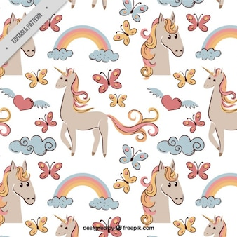 Sketches colored unicorn and elements pattern