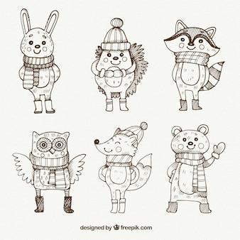 Зарисовки набор прекрасных животных с зимними элементами