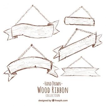Schizzi di cartelli in legno