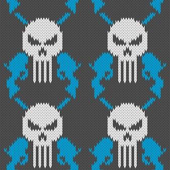 해골과 권총. 두개골과 두 리볼버와 원활한 니트 모직 패턴