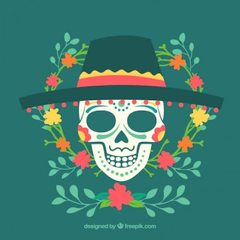 Skull with a hat and floral decorations