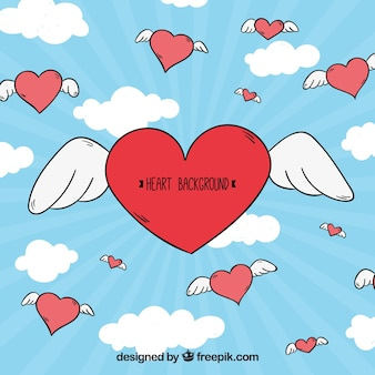 Sky background with hand drawn hearts with wings