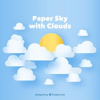 종이 질감에 구름과 태양 배경으로 하늘