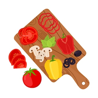Sliced vegetables on cutting board. Pizza ingredients