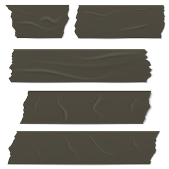 Slices of a black adhesive tape with shadow and wrinkles.