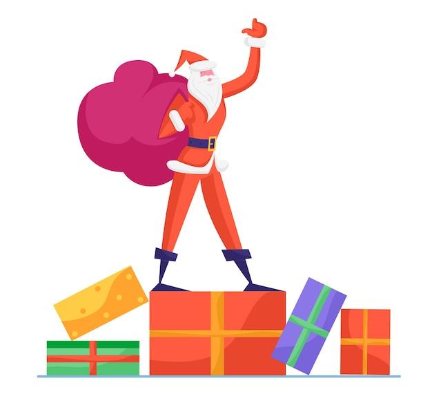 Стройный санта-клаус в красном традиционном костюме держит мешок с подставкой для подарков