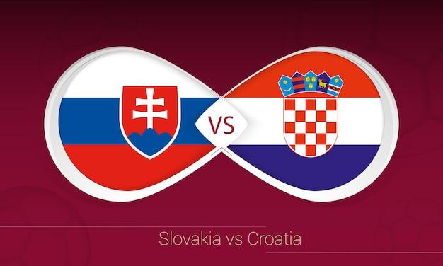 Словакия против хорватии в футбольном соревновании, группа h. versus значок на футбольном фоне.