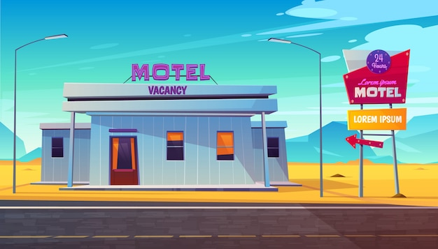 Small, 24 hours, roadside motel building with illuminated road sign near highway