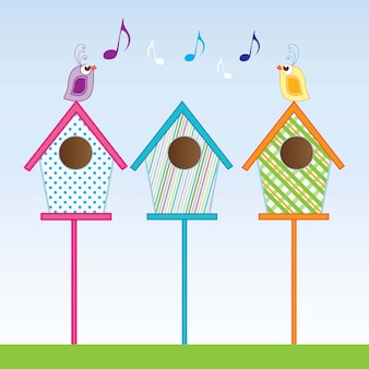 Small birdhouses of various colors vector illustration