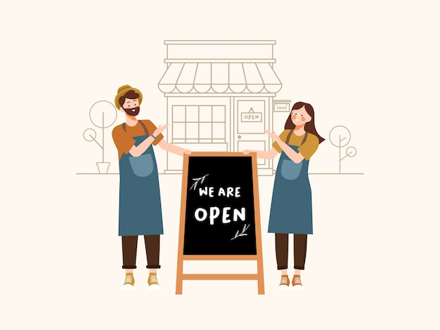 Small business owners stand to greet buyers with we are open blackboard sign