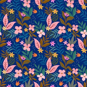 Small pink flowers flowers on blue background seamless pattern.