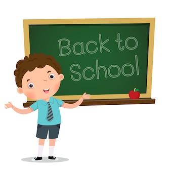 Smart boy presenting something in front of blackboard