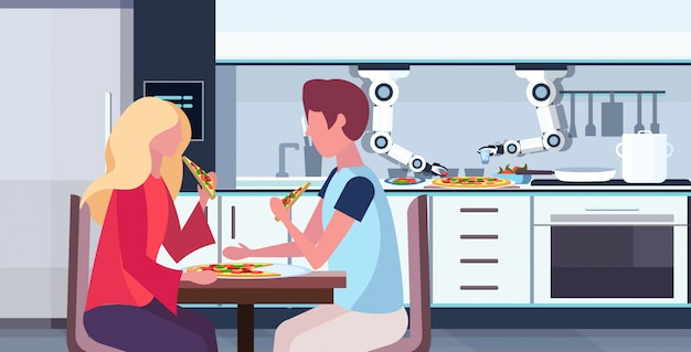 Smart handy chef robot preparing tasty pizza for man woman couple robotic assistant innovation technology artificial intelligence concept modern kitchen interior  horizontal portrait